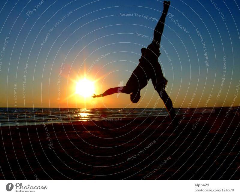 Reaching for the sun Sunset Beach Trick Vacation & Travel Ocean arcobatik Sports