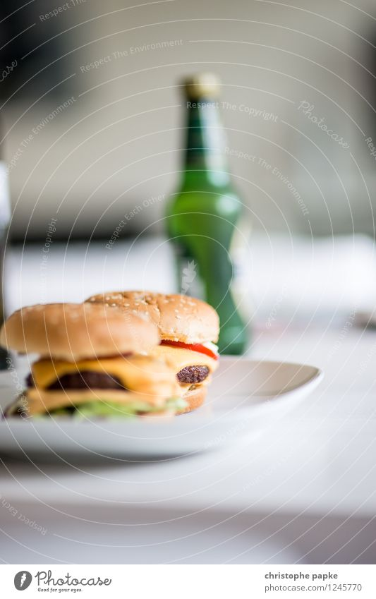 Burger and Beer Food Nutrition Lunch Dinner Fast food Beverage Alcoholic drinks Plate Flat (apartment) Table Living room Delicious Hamburger Cheeseburger