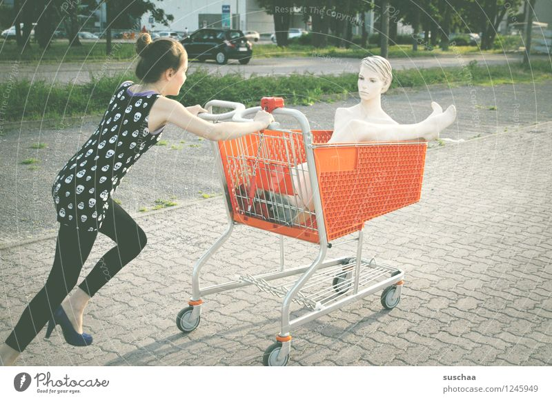 go shopping ...... Child Girl Young lady Youth (Young adults) Young woman Shopping Push Running Shopping Trolley Mannequin High heels Infancy Whimsical Strange