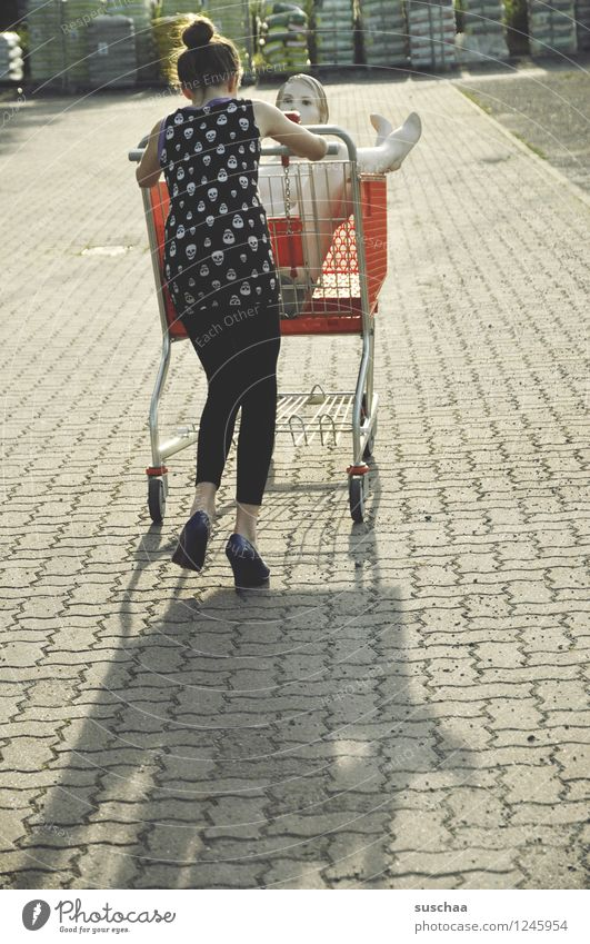 go shopping ..... Child Girl Young lady Youth (Young adults) Young woman Shopping Push Running Shopping Trolley Mannequin High heels Infancy Whimsical Strange