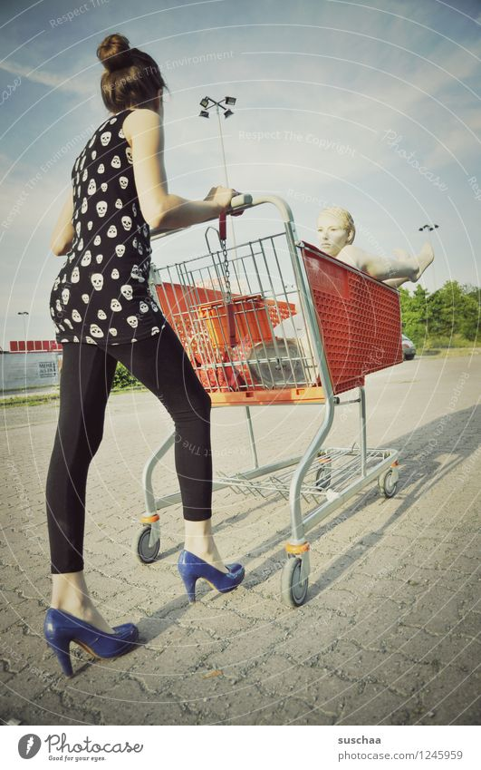 go shopping .... Child Girl Young lady Youth (Young adults) Young woman Shopping Push Running Shopping Trolley Mannequin High heels Infancy Whimsical Strange