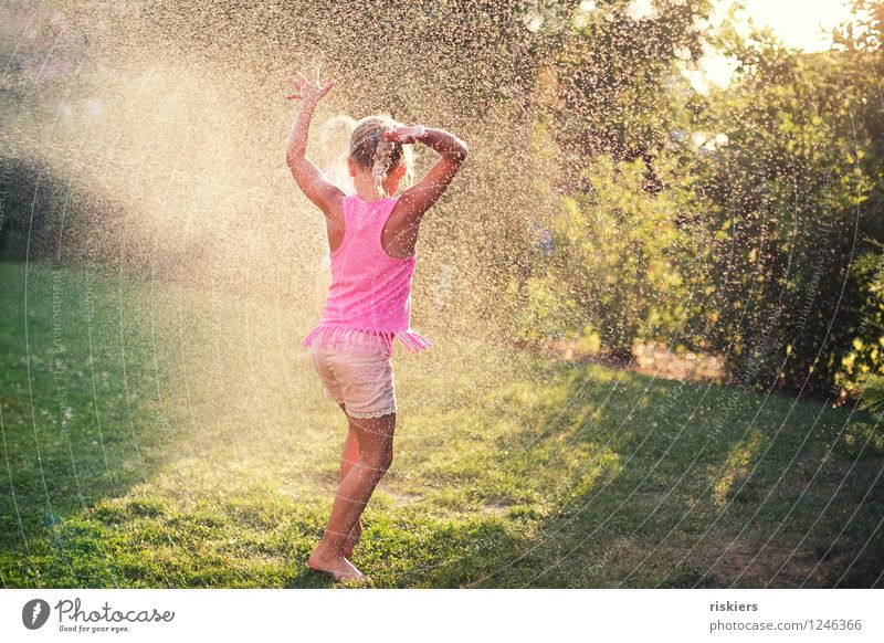 Human being Child Summer Water Joy Girl Natural Feminine Playing Happy Laughter Garden Party Glittering Rain Illuminate