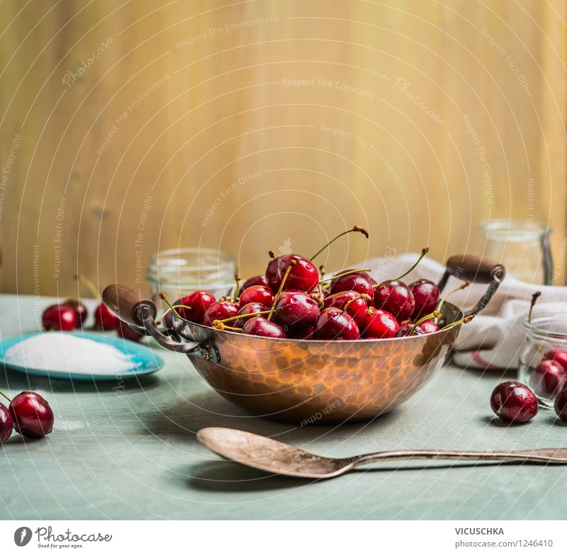 Sweet cherries in pot on kitchen table Food Fruit Nutrition Organic produce Beverage Juice Pot Glass Spoon Style Healthy Eating Life Summer Table Kitchen