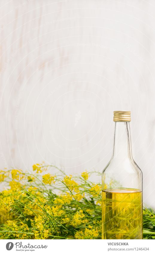 Rapeseed oil in bottle on white wood background Food Herbs and spices Cooking oil Nutrition Organic produce Vegetarian diet Diet Bottle Style Design