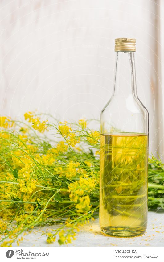 Glass bottle with rapeseed oil Food Cooking oil Organic produce Vegetarian diet Diet Bottle Style Design Healthy Eating Life Nature Plant Leaf Blossom