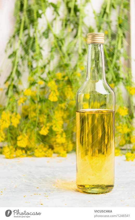 Glass bottle with rapeseed oil Food Cooking oil Nutrition Organic produce Vegetarian diet Diet Bottle Style Design Healthy Eating Life Summer Nature Plant Leaf