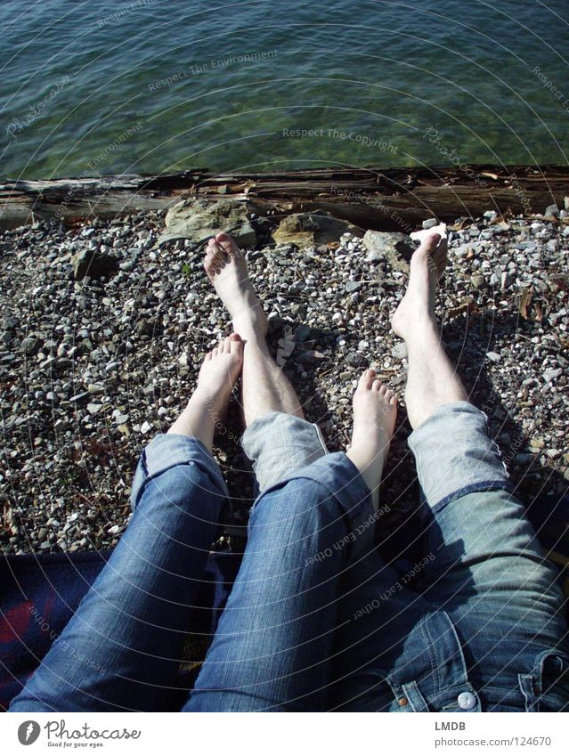 Make blue Pants Relaxation 2 Friendship Lake Bathing place Calm Dream Together Love Jeans Feet Legs Couple Sand Stone Coast Sun Lie stretch Gravel In pairs