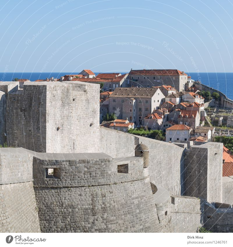 City wall Dubrovnik Old town Manmade structures Architecture Wall (barrier) Wall (building) Tourist Attraction Landmark Monument Blue Gray Testing & Control