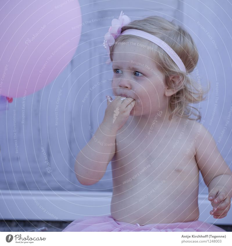 Smash cake Party Human being Feminine Child Toddler Girl 1 1 - 3 years Eating Colour photo Exterior shot Day Looking away