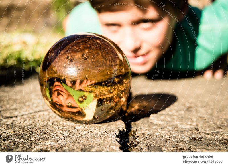 the observer Human being Masculine Child Boy (child) Brother Infancy 1 3 - 8 years Nature Summer Beautiful weather Glass Observe Smiling Lie Yellow Gold Green