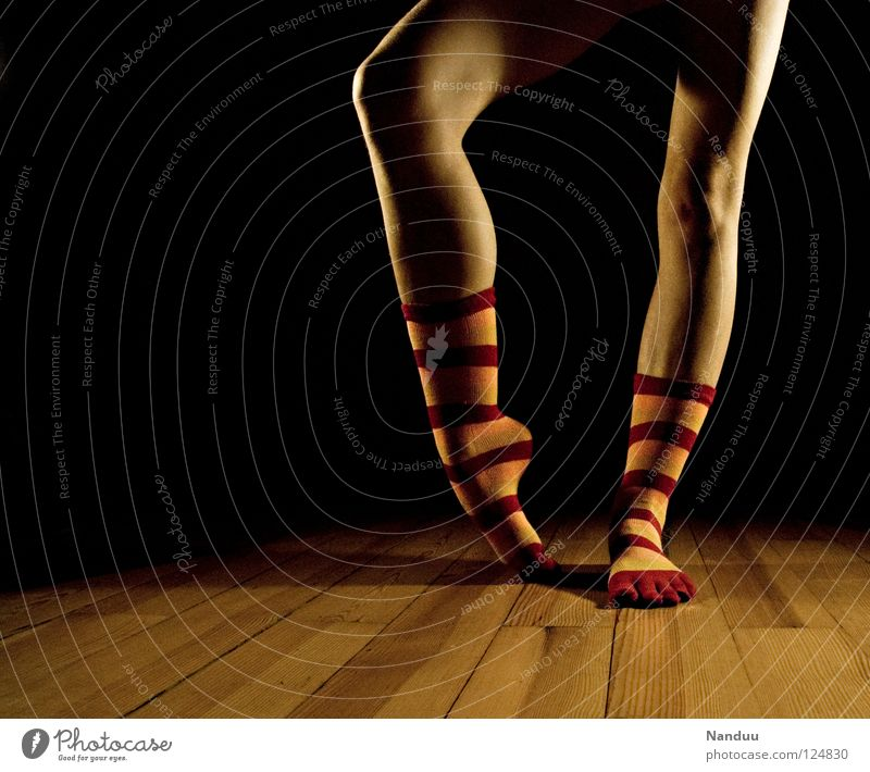 La danse des chaussettes red-orange Stockings Striped socks Sock Ballet Parquet floor Stage Dark Floodlight Dance Low-key Leisure and hobbies Art Culture