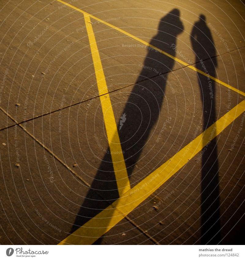 ATZE+ISCHE Going Concrete Hard Uncomfortable Yellow Triangle Geometry Furrow Sunlight Shadow Together Long Line Stripe Yolk Man Woman Masculine Dark