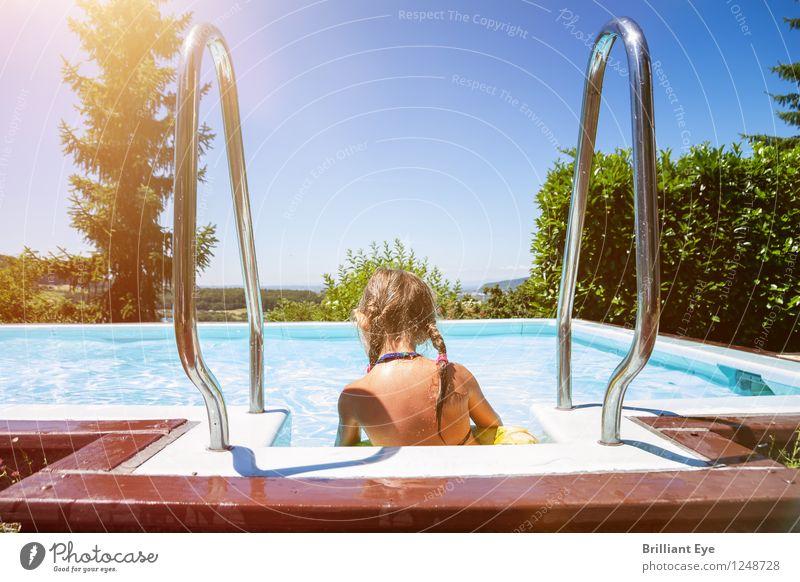 Girl splashing at the pool side Life Summer Swimming pool Child Human being Nature Swimming & Bathing Water Sit Garden Beautiful weather Sunbeam Braids
