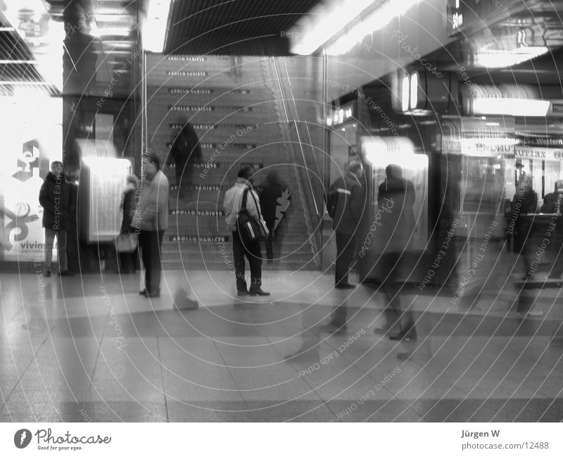 at station 2 Blur Diffuse Long exposure Train station Human being Black & white photo Stairs Haste human railway station hurries