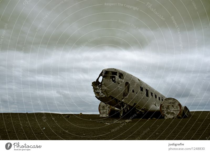 Iceland Nature Clouds Climate Transport Means of transport Aviation Airplane wrecked aircraft Old Exceptional Threat Dark Creepy Broken Wild Moody