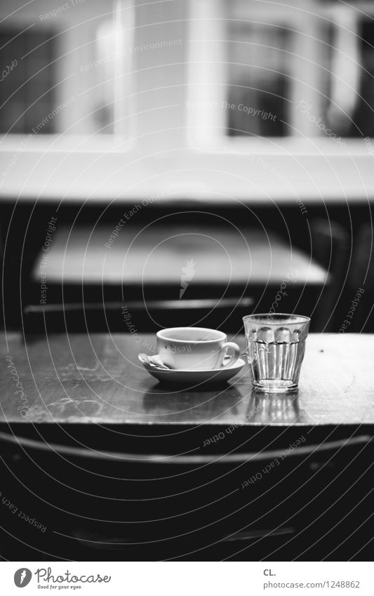 at the café Beverage Hot drink Drinking water Coffee Cup Glass Chair Table Break Café Restaurant Black & white photo Interior shot Deserted Day