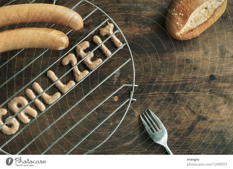 The letters GRILLZEIT on a grill, two sausages, a bread roll and a fork on a rustic wooden table Food Meat Sausage Roll BBQ Boiled sausage Bratwurst Nutrition