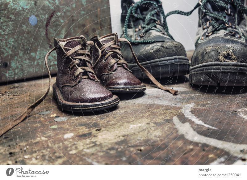Old shoes from father and little son on a rustic wooden floor Parenting Work and employment Craftsperson Workplace Craft (trade) Construction site Footwear