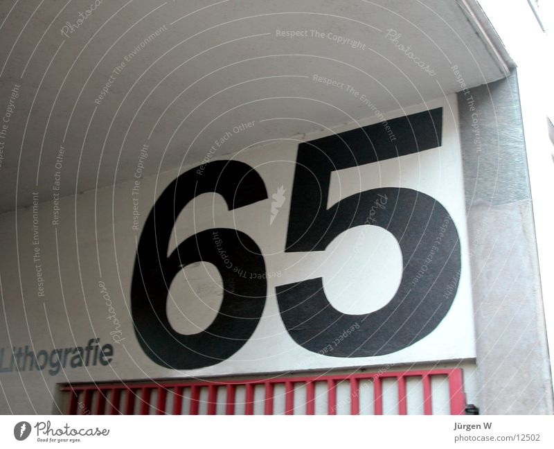 65 Digits and numbers House number Typography Wall (building) Photographic technology Characters writing Wall (barrier)
