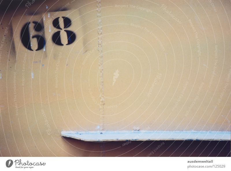 [68] Digits and numbers Wall (building) House (Residential Structure) Black Beige Leipzig South Detail Colour two-digit Wooden board suburban south Analog color