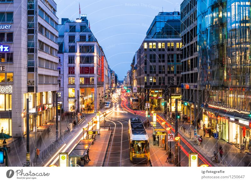 Night time at Berlin Friedrichstrasse Germany Rush hour Road traffic Train travel Street Traffic light Tram Train station Emotions Might Determination
