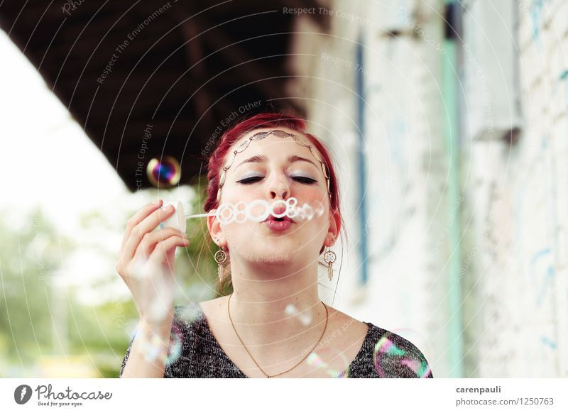 bubbles Feminine Young woman Youth (Young adults) 1 Human being 18 - 30 years Adults Red-haired Toys Kitsch Odds and ends Playing Happiness Beautiful Joy