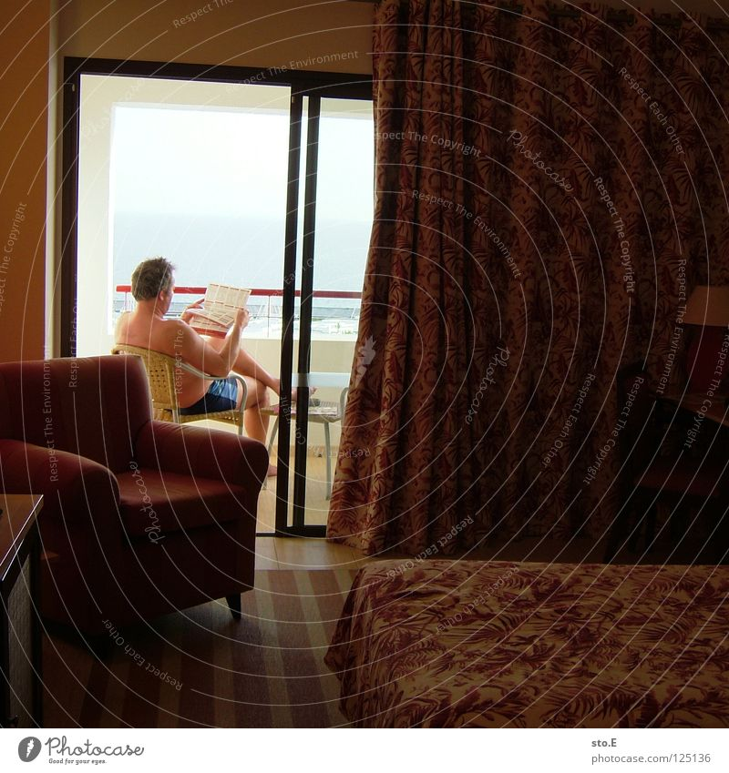 that's vacation! Man Fellow Masculine Lanzarote Landscape Background picture Horizon Ocean Lake Hotel Hotel room Room Armchair Bed Newspaper Reading Balcony