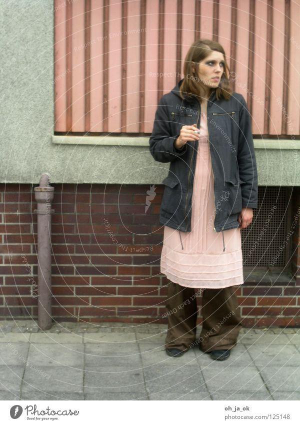 Woman Street Wall (building) Wall (barrier) Cigarette Balcony Sidewalk Hooded (clothing)