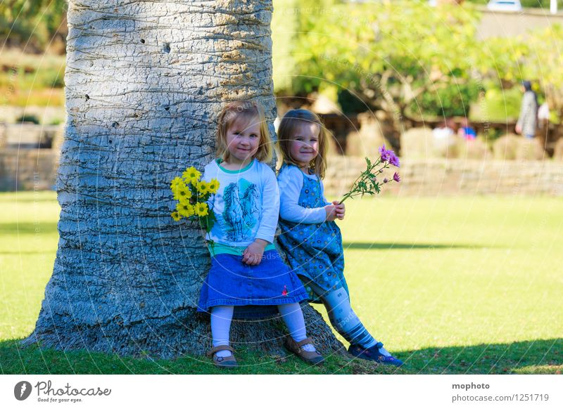 sisters Playing Parenting Child Human being Feminine Toddler Girl Brothers and sisters Sister Family & Relations Infancy 2 1 - 3 years Nature Flower Garden Park