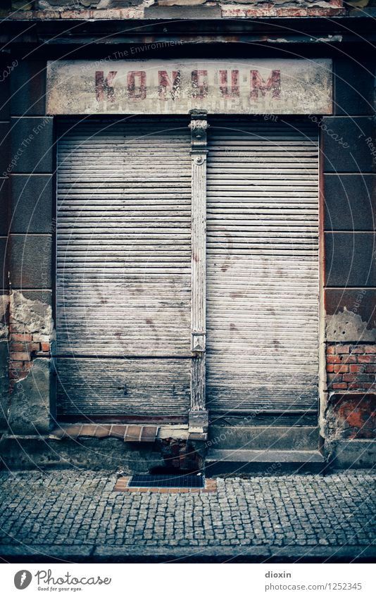 Spreedorado | Consumption Deserted House (Residential Structure) Building Store premises Facade Window Shop window Roller shutter Roller blind Company sign Old