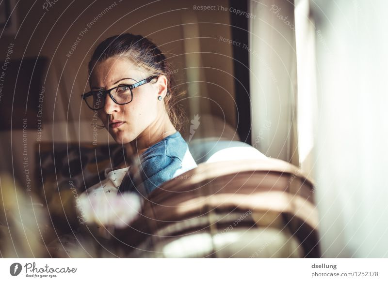 Rigid view of a woman in an apartment with sunlight Human being Feminine Young woman Youth (Young adults) 1 18 - 30 years Adults Observe Exceptional Threat