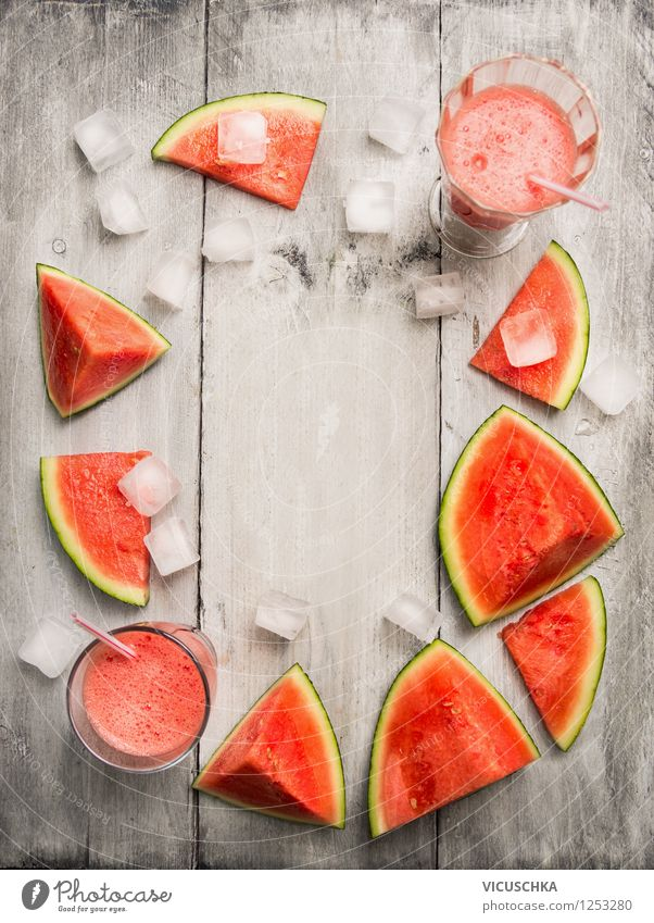 Watermelon juice with ice cubes on the wooden table Food Fruit Nutrition Organic produce Vegetarian diet Diet Beverage Cold drink Juice Glass Style Design