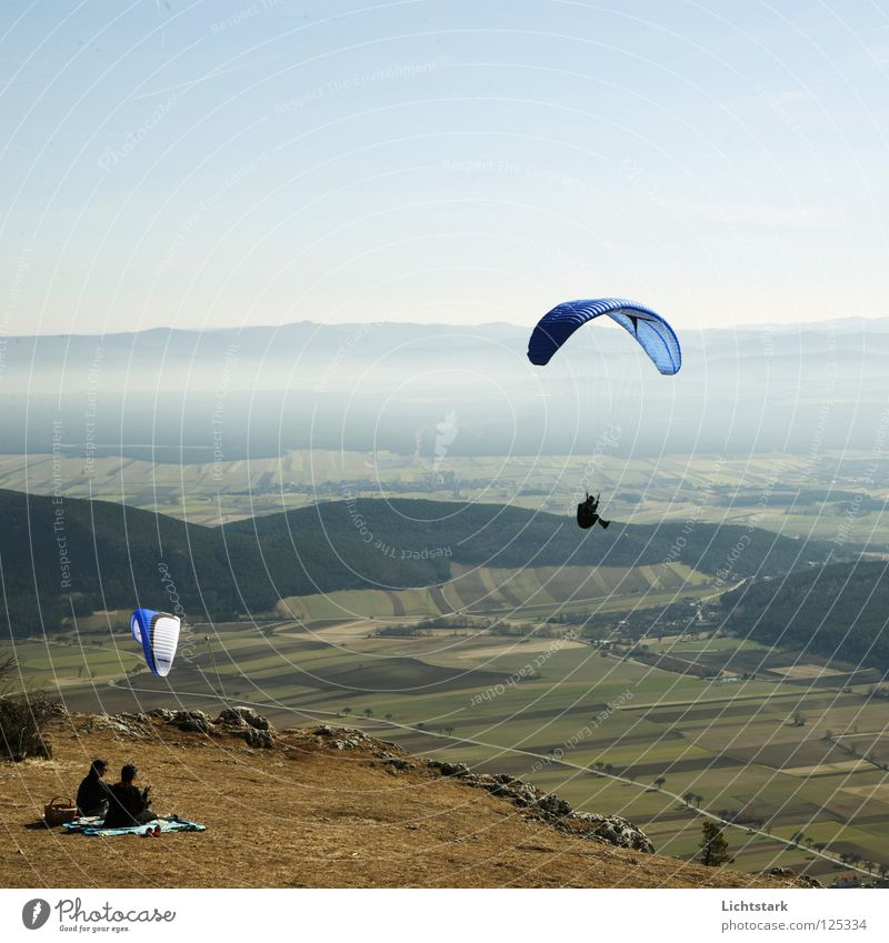 Sky Blue Red Colour Freedom Warmth Air Wind Flying Beginning Tourism Leisure and hobbies Alps Sporting event Austria Paragliding