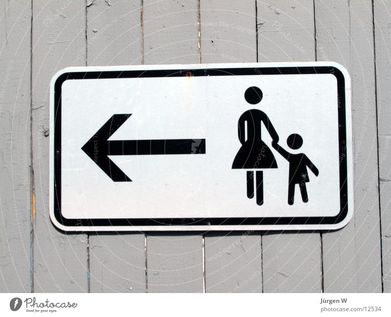 Woman Child Signs and labeling Things Arrow Direction Fence