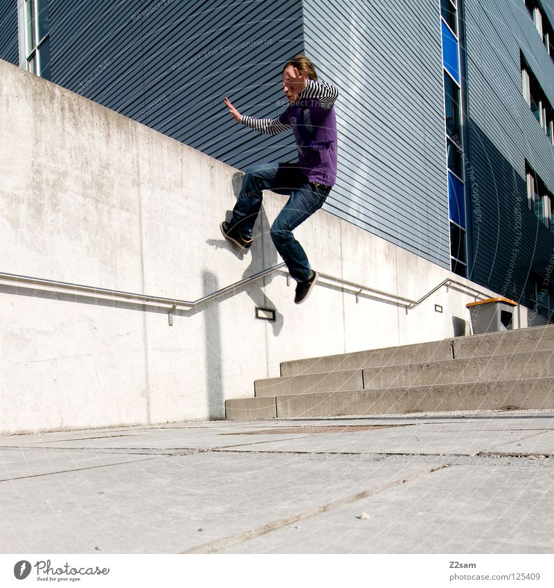 Human being Man Blue Wall (building) Architecture Wall (barrier) Style Contentment Going Walking Stairs Masculine Modern Speed Floor covering Corner