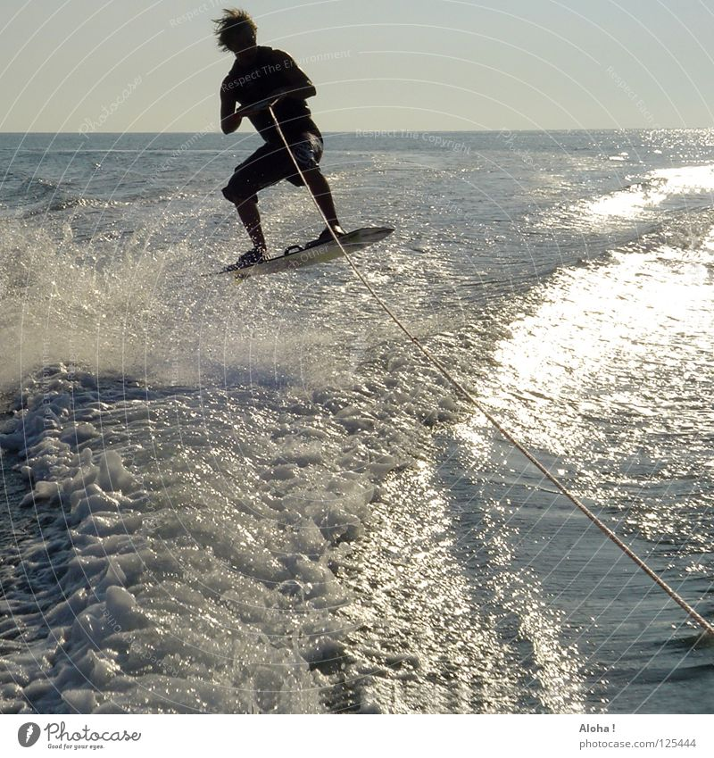 have you been dragged along? Summer Waves Ocean Watercraft White Black Suit Foam Splash of water Wet Leisure and hobbies Sports Swell Driving Speed Jump Wetsuit