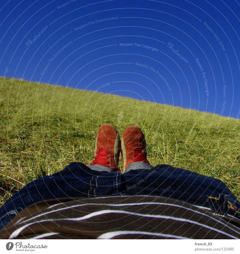 Fault-in-the-Sun-Lay Perspective Sky Cyan Brilliant Footwear Pants Grass Meadow T-shirt Red White Stripe Striped Lie Relaxation To enjoy Green Juicy Spring