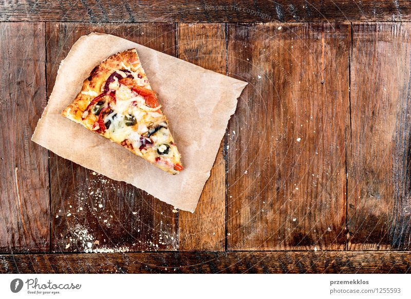 Slice of pizza on piece of paper Food Fresh Copy Space Table Paper Vegetable Meal Dinner Home Horizontal Rustic Pizza Fast food Ready Home-made