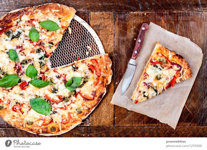 Fresh homemade pizza Food Vegetable Dinner Fast food Italian Food Knives Table Paper cuisine Home Home-made Horizontal Meal Pie piece Pizza popular prepared