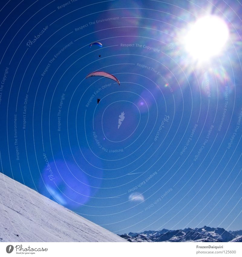 paraglider 1 Parachute Airplane Flying sports Vapor trail Reflection Paragliding Red Sunbeam Radiation Federal State of Tyrol Transport White Westendorf Winter