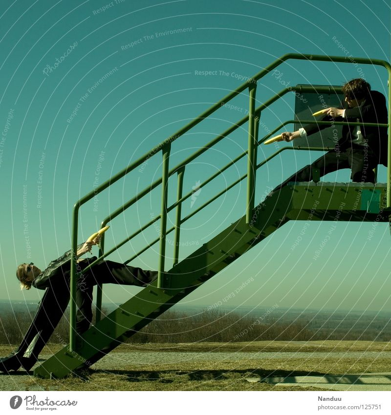 Human being Woman Man Green Wall (building) Playing Funny Leisure and hobbies Stairs Masculine Crazy Tower Posture Film industry Handrail Media