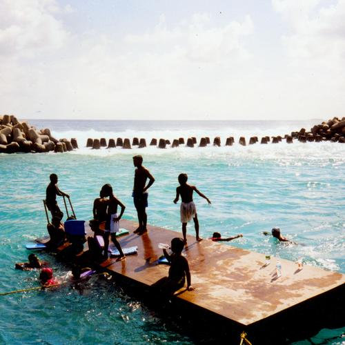 learning to swim in maldivian Colour photo Exterior shot Joy Happy Contentment Swimming & Bathing Vacation & Travel Freedom Summer Sun Ocean Island Child