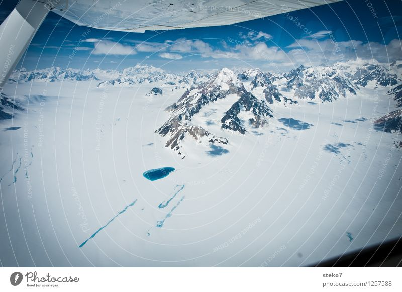 Blue White Loneliness Far-off places Cold Mountain Flying Lake Uniqueness Snowcapped peak Glacier Gigantic Alaska Wing tip