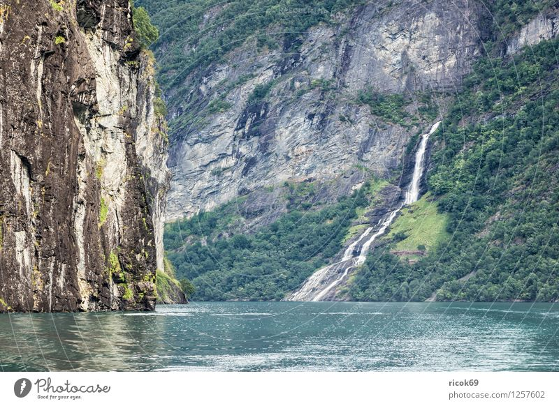 Waterfall in the Geirangerfjord Relaxation Vacation & Travel Mountain Nature Landscape Clouds Fjord Idyll Tourism Norway Møre og Romsdal destination Sky voyage