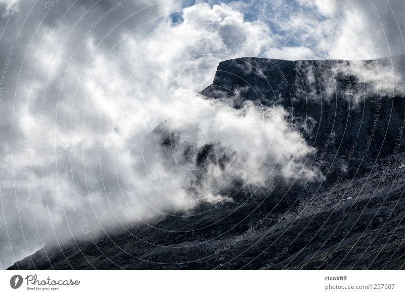 Mountain with clouds Relaxation Vacation & Travel Sun Nature Landscape Clouds Idyll Tourism Norway Møre og Romsdal destination Sky voyage Scandinavia