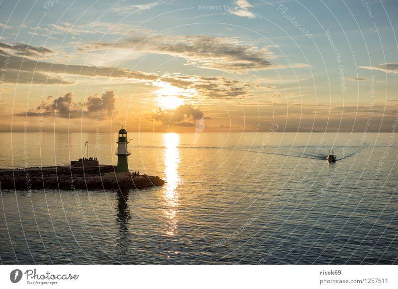 Warnemünde Vacation & Travel Ocean Clouds Coast Baltic Sea Lighthouse Architecture Tourist Attraction Landmark Watercraft Nature Tourism Mole Sunset Sky Rostock