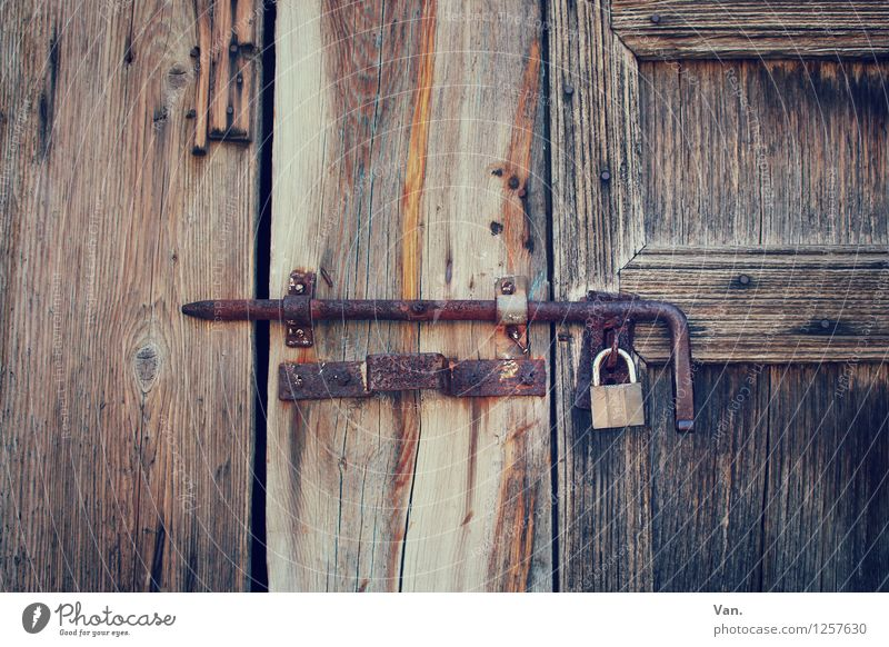 behind lock and bolt Gate Door Lock Locking bar Wood Old Brown Rust Colour photo Subdued colour Exterior shot Detail Deserted Day Contrast