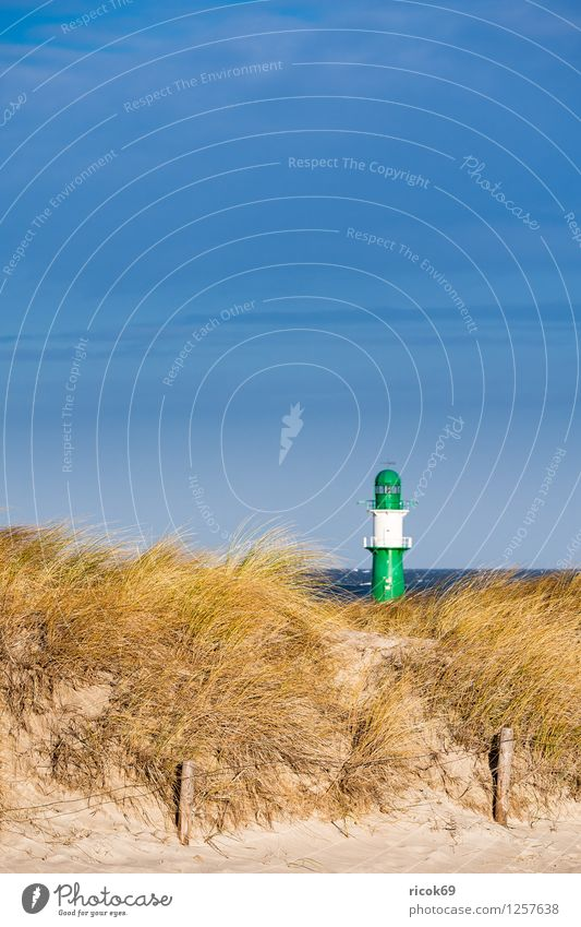 Dune in Warnemünde Relaxation Vacation & Travel Beach Ocean Nature Landscape Clouds Wind Gale Coast Baltic Sea Lighthouse Blue Yellow Green Tourism pier light