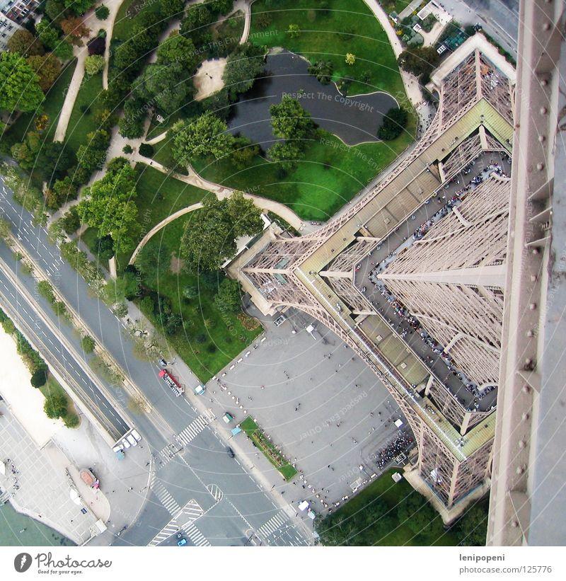 On a small foot Eiffel Tower Paris France Steel Iron Landmark Famousness Bird's-eye view Dangerous Deep Small Reaction Under Park Carrier Wind Pond