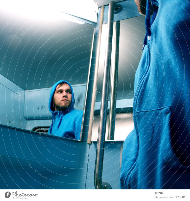 noid Sky blue Light blue Mirror Aggravation Hooded (clothing) Pursue Looking Multiple Portrait photograph Neon light Fear Panic Dangerous Man Blue Bluish